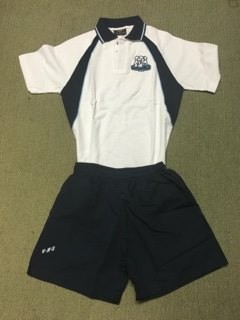 Junior boys uniform sample showing the custom polo shirt with the navy blue shorts.