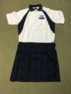 Junior girls uniform example showing the custom polo top with the tartan skirt.